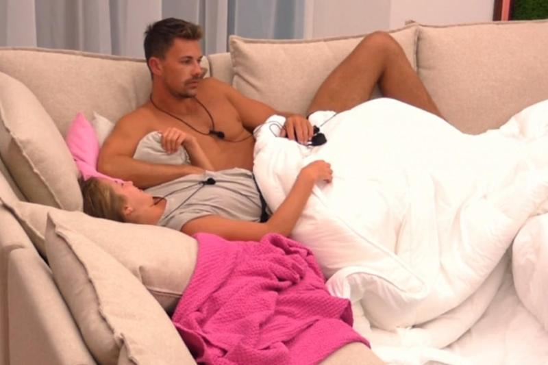 Getting cosy: Georgia and Sam cuddle on the sofa (ITV)