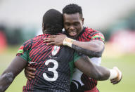 Kenya's Alvin Otieno, left, and teammate Alvin Marube celebrate a try against Germany during a quarterfinal match at the HSBC Canada Sevens rugby tournament in Edmonton, Alberta on Sunday, Sept. 26, 2021. (Jason Franson/The Canadian Press via AP)