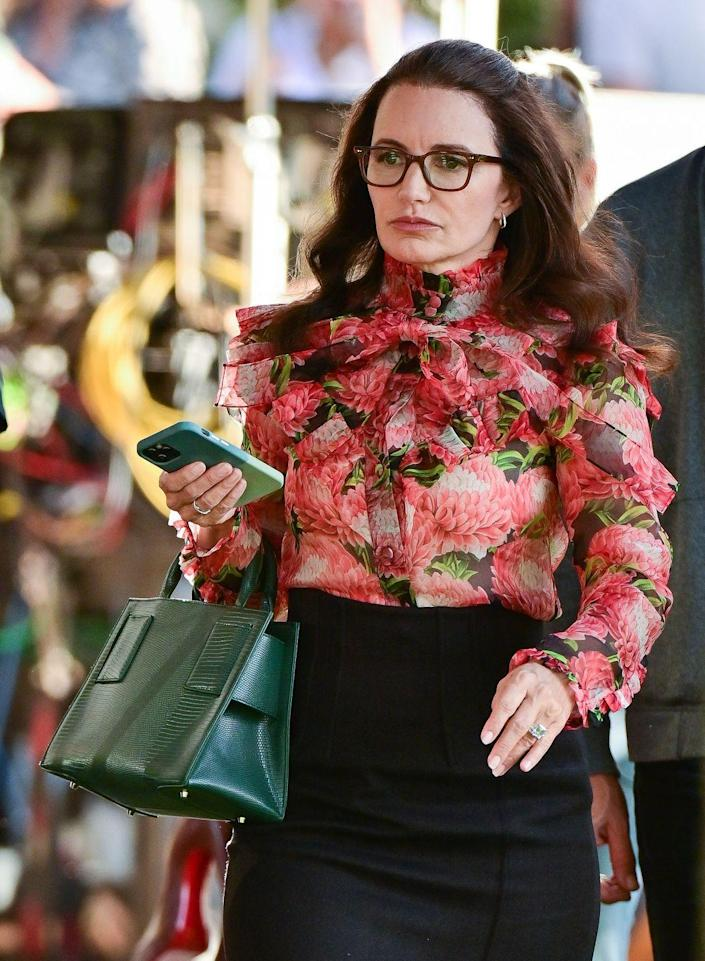 <p>Kristin Davis stepped out in a Gucci pussy bow floral silk chiffon blouse, paired with a Brandon Blackwood Kuei medium bag and brown Louboutin Pigalle Plato pumps (not pictured).</p>