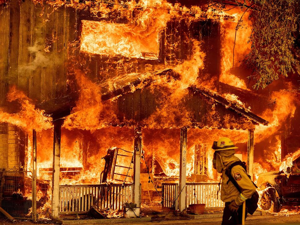 Fire consumes a home as the Sugar Fire, part of the Beckwourth Complex Fire, tears through Doyle, Calif., on Saturday 10 July 2021 (AP)