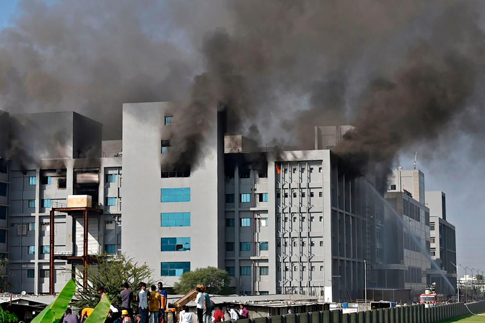 <p>Firefighters try to control a fire that broke out at India's Serum Institute in Pune </p> (AFP via Getty Images)