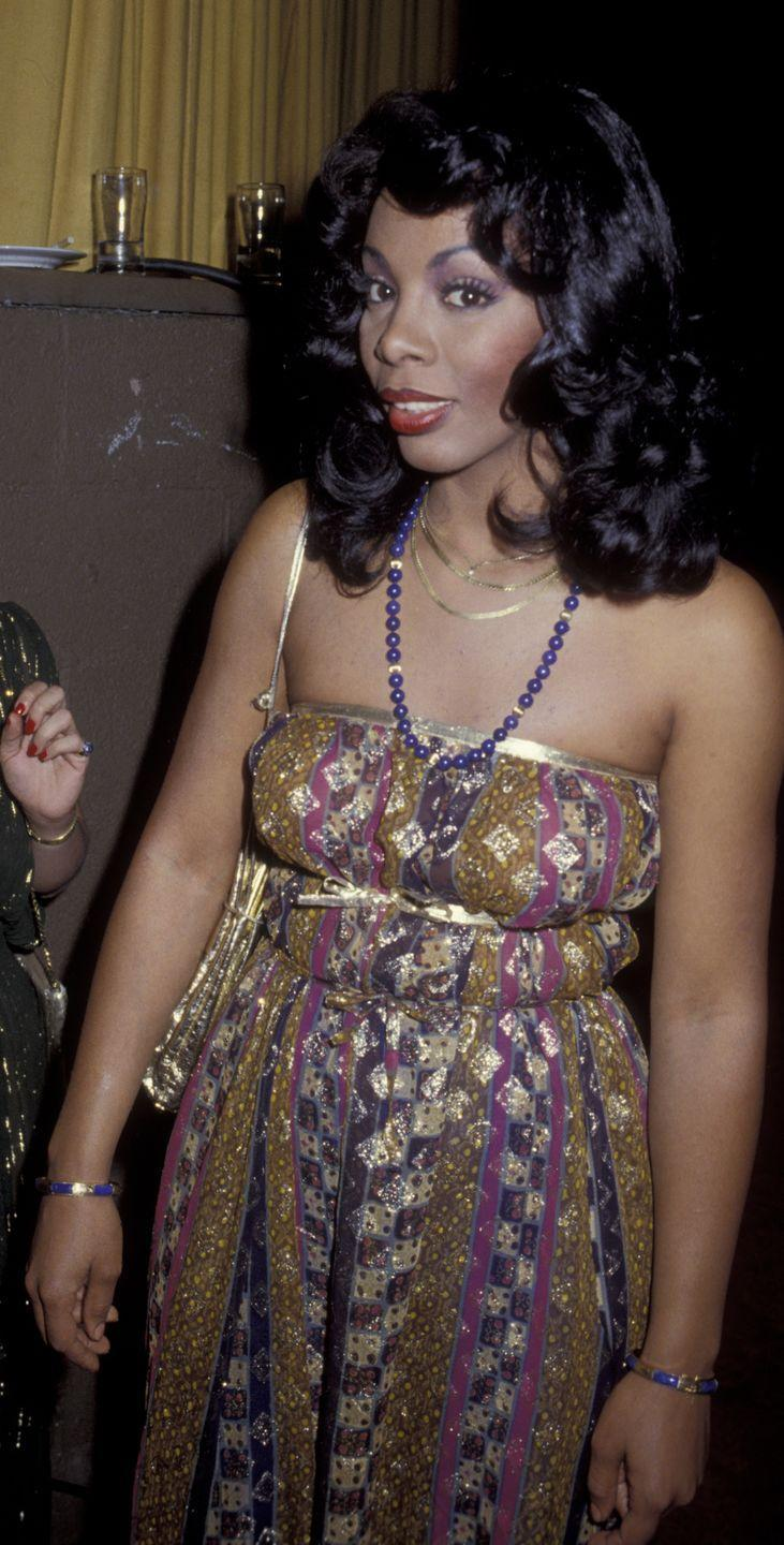 <p>In 1979, the singer wore this colorful strapless number, pairing it with a purple beaded necklace.</p>