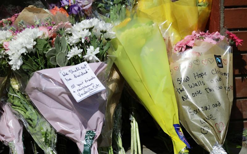 Floral tributes - Credit: KEVIN COOMBS/Reuters