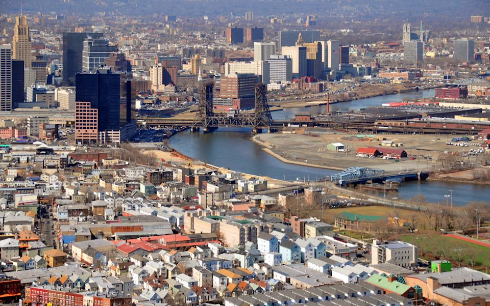 Newark, New Jersey, USA: downtown buildings seen from the air, Passaic River and Harrison on the right - Dock Drawbridge - in the foreground the Ironbound, a Portuguese neighborhood - photo by M.Torres