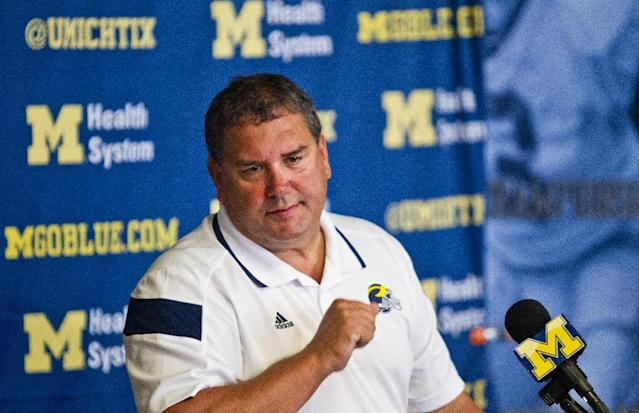 FILE - In this Aug. 10, 2014, file photo, Michigan head coach Brady Hoke answers questions from the media during a news conference at the NCAA college football team's preseason media day in Ann Arbor, Mich. Coaches often say they are always on the hot seat. That might be true, but some seats are hotter than others. A few coaches in high-profile positions heading into 2014 very much in need of winning records and quality victories. (AP Photo/Tony Ding, File)