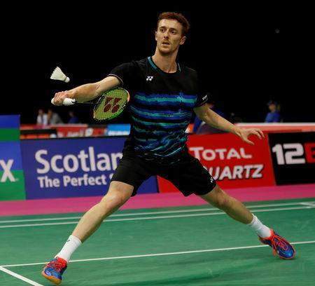 Badminton - Badminton World Championships - Glasgow, Britain - August 21, 2017 Scotland's Kieran Merrilees in action against China's Lin Dan REUTERS/Russell Cheyne