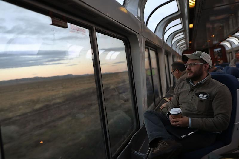 (Bloomberg Opinion) -- By the time it crossed the Mississippi River at Burlington, Iowa, last week, our California Zephyr was running more than eighthours late on its journey from the San Francisco Bay Area to Chicago. The last meal, a free, off-menu beef stew, had just been served in the dining car. My wife and I opted instead to consume a couple of Maruchan Instant Lunch cups, purchased in the cafe, accompanied by a half bottle of Kendall-Jackson chardonnay, also from the cafe. Occasional wafts of sewage odor tainted the air, the aging Superliner cars creaked and rattled, and the dining- and sleeping-car staff exuded fatigue and resignation. Even the conductor, who had just gotten on at Ottumwa, sounded appropriately defeated when he reaffirmed over the loudspeaker that, yes, every connecting train in Chicago, including the Lakeshore Limited to New York for which we had tickets,would be leaving before our train got there.Things did improve a little once we entered Illinois. My wife got an unexpected email from Amtrak with a PDFticket attached for the next day's Lakeshore Limited, in more spacious accommodations than what we had originally booked. The train also started going consistently faster, mostly between 70 and 80 miles an hour, chipping away at our estimated arrival time by a minute here and a minute thereuntil we were forced to sit still outside the Chicago suburb of Naperville to let a Metra commuter train go by. After a lovely day in Chicago (we stayed with friends, but Amtrak would have put us up in a hotel if needed), we boarded the train to New York only to learn that its departure would be delayed two hours to wait on two very late trains arriving via different routes from Los Angeles, the Southwest Chief and Texas Eagle. The conductor sounded irked about this rather than resigned, and over the next 20 hours we made up about a third of the lost time, arriving in Manhattan in the middle of a minor blackout that spared Penn Station but made getting hom