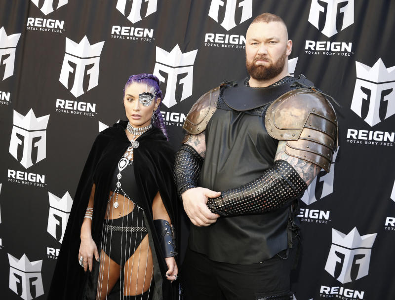 "Former WWE star Natalie Eva Marie and ""Game of Thrones"" actor Hafþór Júlíus Björnsson celebrate the launch of Reign Total Body Fuel on April 16, 2019 in New York City. (Photo by Brian Ach/Getty Images)"