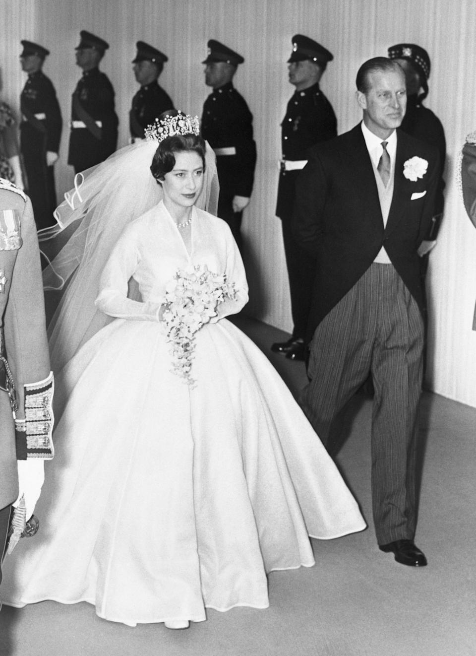 Princess Margaret is accompanied by her brother-in-law Prince Philip during her wedding to Antony Armstrong-Jones at Westminister Abbey.