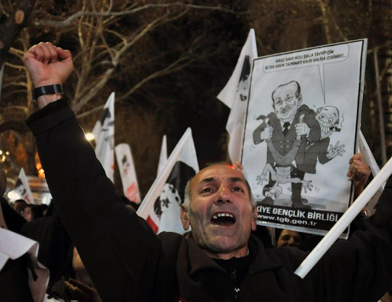 "A protester shouts "" catch the thief!..""as several hundred people call on the government to resign during a protest in Ankara, Turkey, late Friday, Dec. 27, 2013. Prime Minister Erdogan on Friday faced mounting accusations of trying to cover up a corruption scandal that has implicated his allies after a prosecutor said he was being prevented from expanding a corruption probe. Erdogan was forced to reshuffle his government this week after three ministers, whose sons were detained as part of the probe, resigned.(AP Photo)"