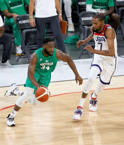 PHOTO: Ike Nwamu #34 of Nigeria drives against Kevin Durant #7 of the United States during an exhibition game at Michelob ULTRA Arena ahead of the Tokyo Olympic Games, July 10, 2021, in Las Vegas. (Ethan Miller/Getty Images)