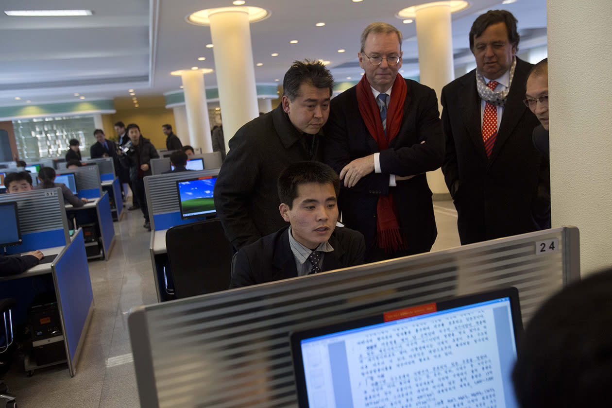 Executive Chairman of Google, Eric Schmidt, third from left, and former New Mexico governor Bill Richardson, second from right, watch as a North Korean student surfs the Internet at a computer lab during a tour of Kim Il Sung University in Pyongyang, North Korea.