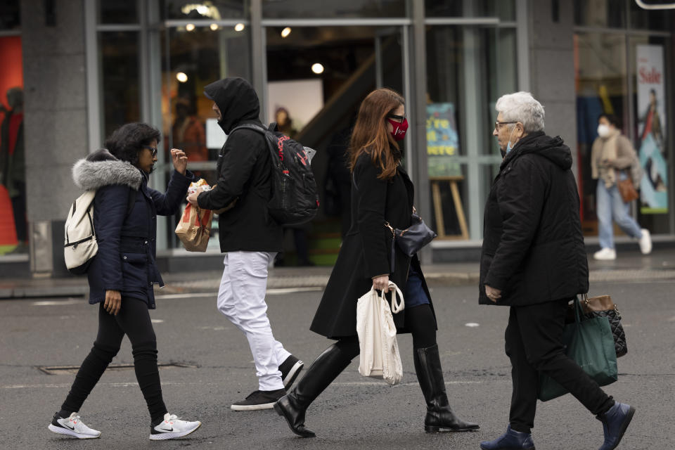 SYDNEY, AUSTRALIA - JUNE 21: Pedestrians are seen at Bondi Junction on June 21, 2021 in Sydney, Australia. A cluster of COVID-19 cases in Sydney's eastern suburbs continues to grow, causing the government to impose restrictions including mandatory indoor mask-wearing in several jurisdictions. NSW Premier Gladys Berejiklian is urging people to get tested to stop the spread and limit further restrictions. (Photo by Brook Mitchell/Getty Images)