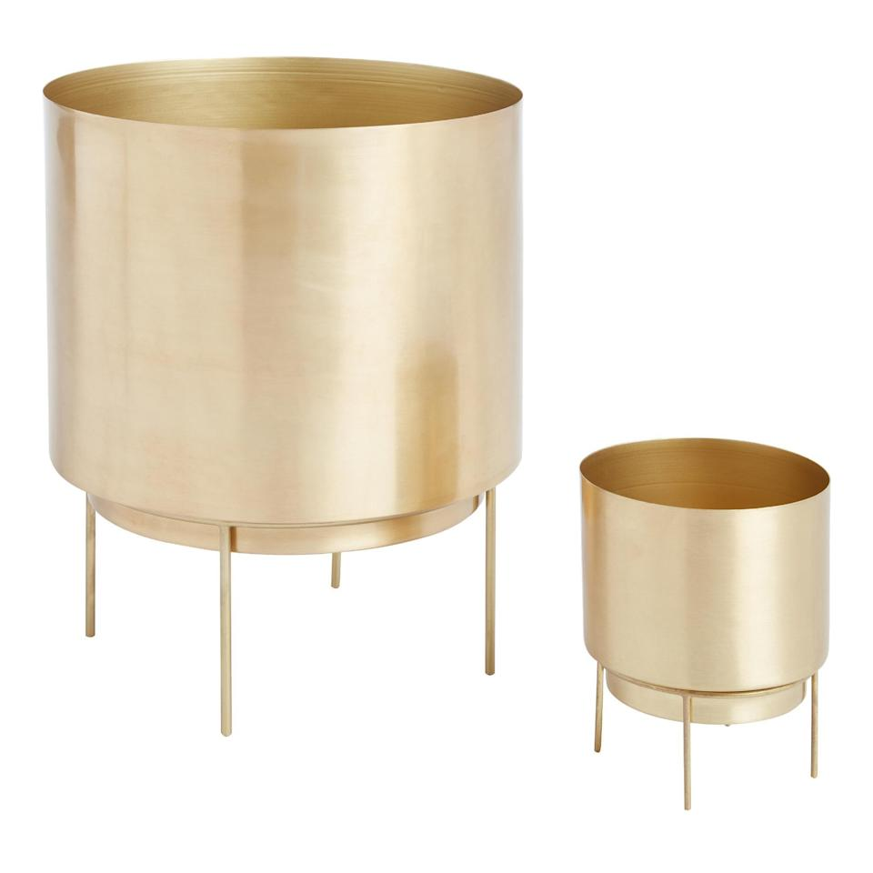 """<h2>World Market Brushed Gold Planter With Stand </h2><br>For the minimalists that still live for glam: add a touch of sparkle to your all-white spotless kitchen with one of these golden plant homes and a nice small leafy friend. Or, for the maximalists who can't stop adding things to their space: take advantage of this planter's bright-yet-sleek design and add color to a room without overwhelming it. <br><br><em>Shop </em><a href=""""http://worldmarket.com"""" rel=""""nofollow noopener"""" target=""""_blank"""" data-ylk=""""slk:World Market"""" class=""""link rapid-noclick-resp""""><em><strong>World Market</strong></em></a><br><br><br><strong>Cost Plus World Market</strong> Brushed Gold Planter, $, available at <a href=""""https://go.skimresources.com/?id=30283X879131&url=https%3A%2F%2Fwww.worldmarket.com%2Fproduct%2Fbrass-planter-with-stand.do"""" rel=""""nofollow noopener"""" target=""""_blank"""" data-ylk=""""slk:Cost Plus World Market"""" class=""""link rapid-noclick-resp"""">Cost Plus World Market</a>"""