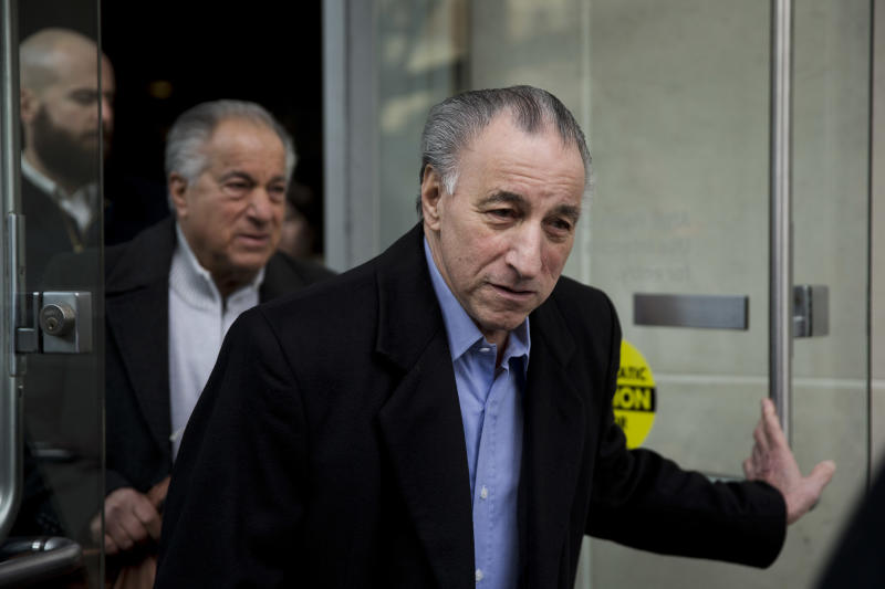 """Joseph """"Uncle Joe"""" Ligambi leaves the U.S. Courthouse in Philadelphia on Tuesday, Jan. 28, 2014. Federal prosecutors in Philadelphia have dropped its criminal case against the reputed Philadelphia mob boss after a second jury deadlocked on the central racketeering charge on Friday, Jan. 24, 2014. (AP Photo/Matt Rourke)"""