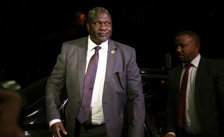 South Sudan rebel leader Riek Machar arrives at the national palace to negotiate with South Sudan President Salva Kiir in Addis Ababa, Ethiopia