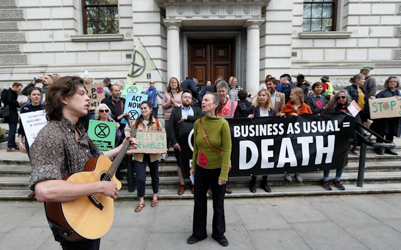 Climate protesters have targeted HM Treasury in Westminster - REUTERS