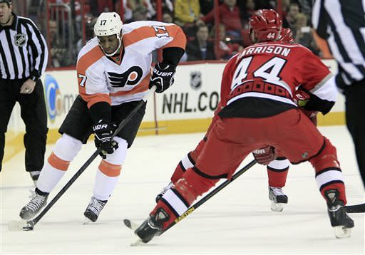 Philadelphia Flyers' Wayne Simmonds (17) works the puck against Carolina Hurricanes' Jay Harrison (44) during the first period of an NHL hockey game on Saturday, April 20, 2013, in Raleigh, N.C. Simmonds scored three goals in the Flyers' 5-3 win. (AP Photo/Karl B DeBlaker)