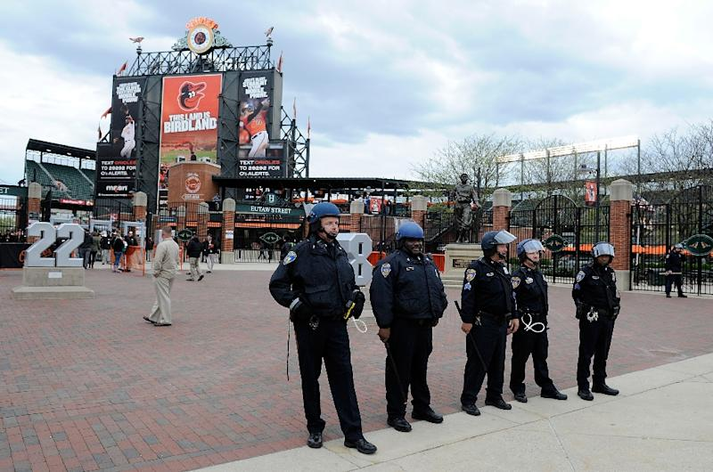 Police stand watch outside Camden Yards before the game was postponed between the Baltimore Orioles and the Chicago White Sox on April 27, 2015 in Baltimore