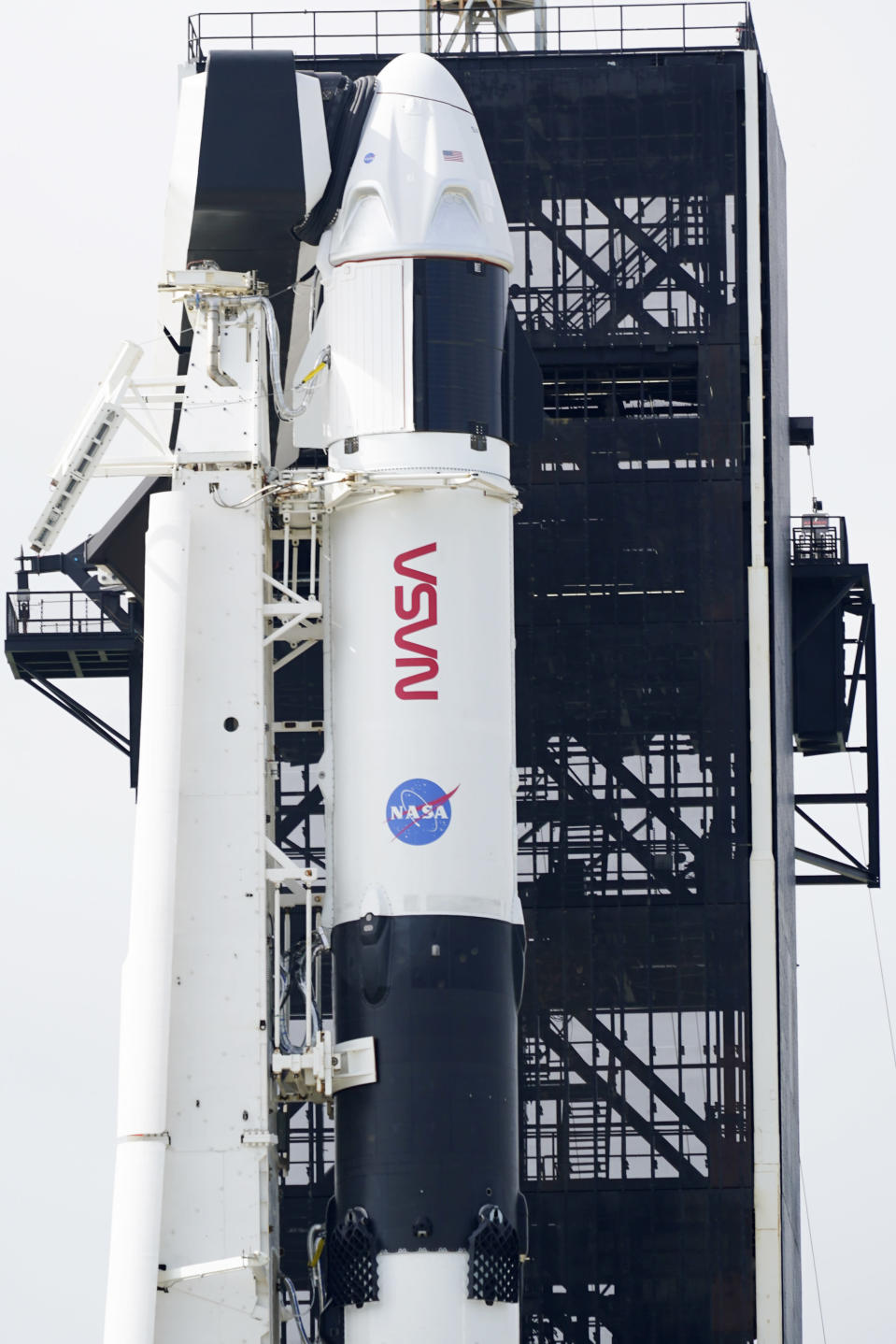 A SpaceX Falcon 9 rocket with the company's Crew Dragon spacecraft onboard is seen on the launch pad at Launch Complex 39A at the Kennedy Space Center in Cape Canaveral, Fla., Friday, Nov. 13, 2020. Four astronauts will fly on the SpaceX Crew-1 mission to the International Space Station. (AP Photo/John Raoux)