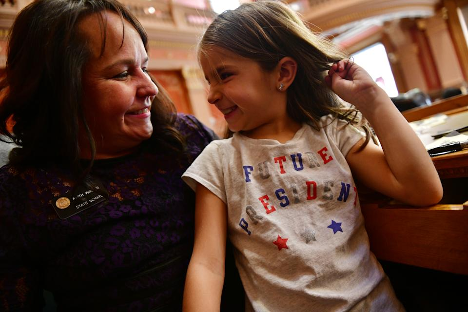 DENVER, CO - JANUARY 4: Sen. Faith Winter, right, celebrates the opening day of the 72nd General Assembly with her daughter Sienna Snook, 7, at the Colorado State Capitol. January 04, 2019. (Photo by Hyoung Chang/The Denver Post via Getty Images)