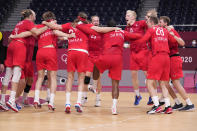 Denmark's team players celebrate as they won the men's semifinal handball match between Spain and Denmark at the 2020 Summer Olympics, Thursday, Aug. 5, 2021, in Tokyo, Japan. (AP Photo/Pavel Golovkin)