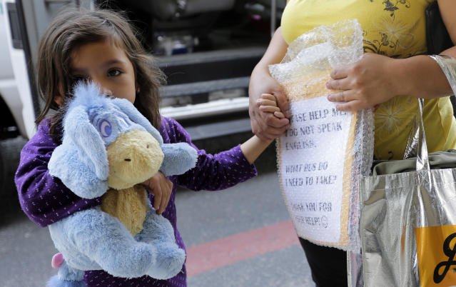 "<span class=""s1"">Immigrants recently released and reunited with family arrive at a Catholic Charities facility in San Antonio on Monday. (Photo: Eric Gay/AP)</span>"