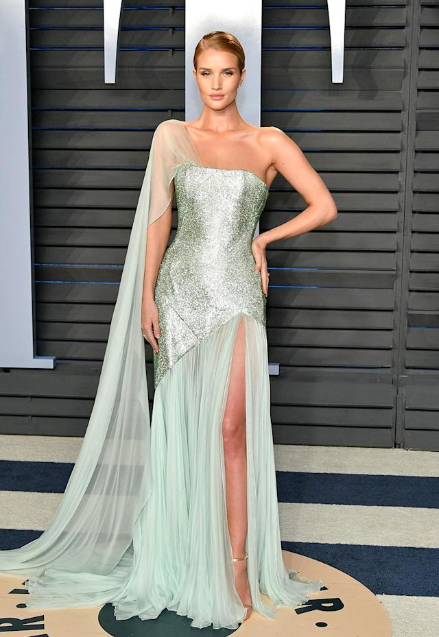 <p>The British model went full glamazon in a pale green gown and a slick side part. (Photo: Dia Dipasupil/Getty Images) </p>