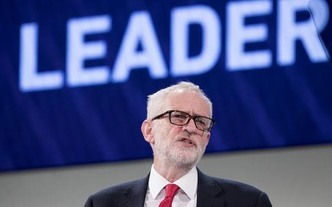 Corbyn wore a pair of soft-edged rectangle frames at the CBI's conference in November 2018 - Credit: Jason Alden/ Bloomberg