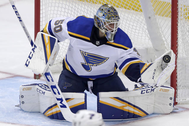 St. Louis Blues goaltender Jordan Binnington gloves a shot during the first period of an NHL hockey game against the Pittsburgh Penguins in Pittsburgh, Saturday, March 16, 2019. (AP Photo/Gene J. Puskar)