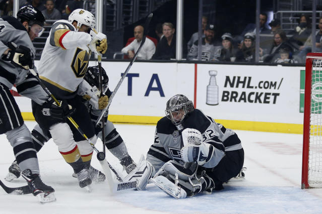 Los Angeles Kings goalie Jonathan Quick (32) stops a shot by Vegas Golden Knights forward Pierre-Edouard Bellemare (41) during the first period of an NHL hockey game Saturday, April 6, 2019, in Los Angeles. (AP Photo/Ringo H.W. Chiu)