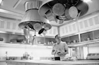 """<p>Frank stands in his spacious modern kitchen, while making himself a sandwich in 1965. The singer spent a great deal of time at the desert house with his second wife, Ava Gardner, however he <a href=""""https://www.wnyc.org/story/house-i-live-frank-sinatra-palm-springs/"""" rel=""""nofollow noopener"""" target=""""_blank"""" data-ylk=""""slk:visited it less and less after their divorce in 1957"""" class=""""link rapid-noclick-resp"""">visited it less and less after their divorce in 1957</a>. </p>"""