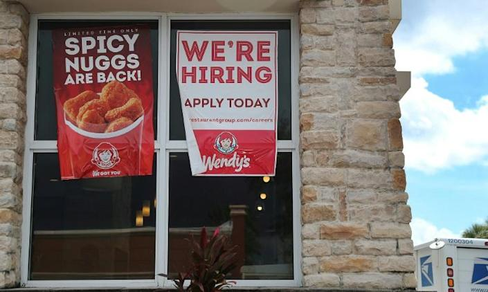 Retailers and restaurants hired at a solid pace in December 2019, but the US monthly average in 2019 was much slower than 2018 (AFP Photo/JOE RAEDLE)