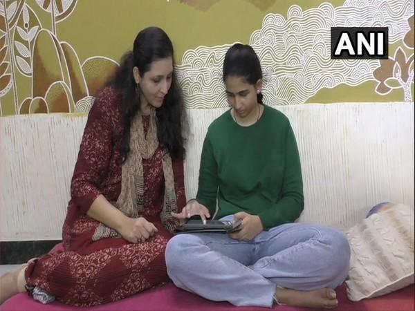 Khushi, the newly appointed Regional Ambassador for India by the United Nations Environment Programme - Tunza Eco-Generation with her mother, Binita. (Photo/ANI)