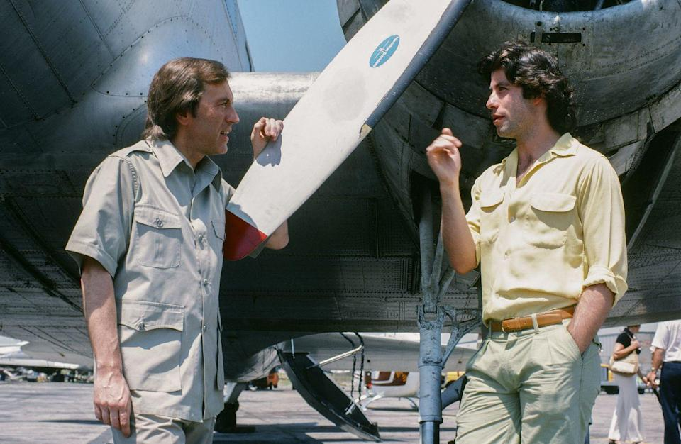 <p>Television host David Frost interviews John Travolta at an airfield in 1978. The movie star ventured into the cockpit during the special. </p>