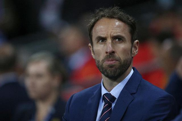 England's Interim manager Gareth Southgate watches his players from the touchline during the friendly international football match between England and Spain at Wembley Stadium, north-west London, on November 15, 2016 (AFP Photo/Adrian Dennis)