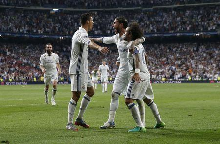Ronaldo destroys Atletico with semi-final hat-trick