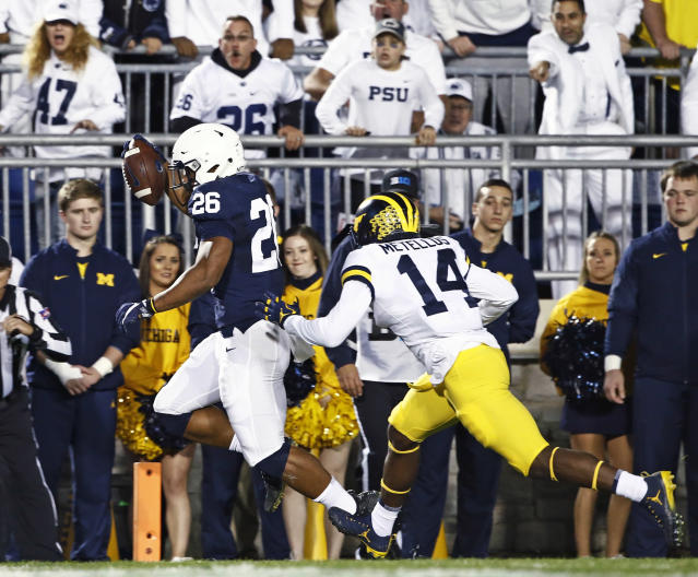 "Penn State's <a class=""link rapid-noclick-resp"" href=""/ncaaf/players/256698/"" data-ylk=""slk:Saquon Barkley"">Saquon Barkley</a> (26) scores a touchdown as Michigan's Josh Metellus (14) tries to chase him down during the first half of an NCAA college football game in State College, Pa., Saturday, Oct. 21, 2017. (AP Photo/Chris Knight)"