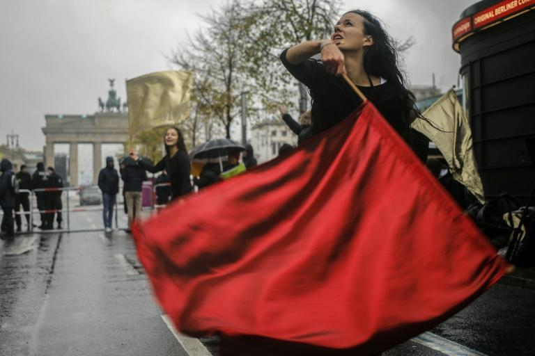 Dancers performed with red and gold flags in front of the Brandenburg Gate