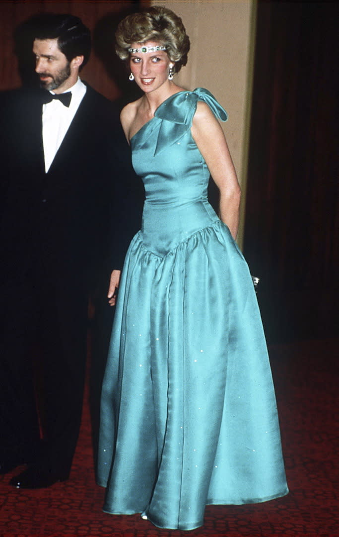 Perhaps one of Princess Diana's most famous evening looks is this turquoise gown by go-to designer David Emanuel. Demonstrating her fashion know-how, she also wore a diamond and emerald choker given to her by Queen Elizabeth II as a head band. <em>[Photo: Getty]</em>