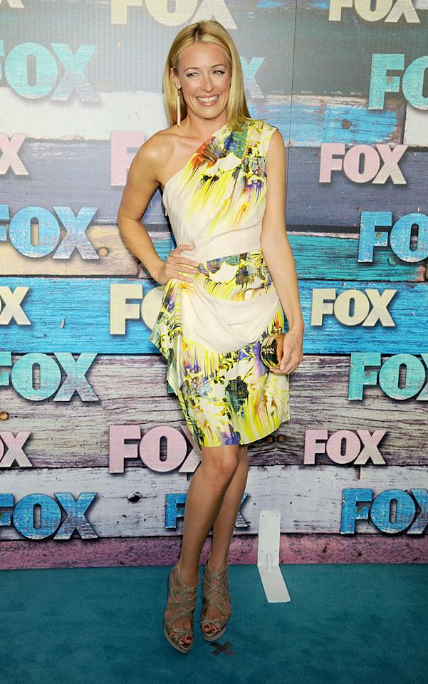 """So You Think You Can Dance"" host Cat Deeley got into the summer spirit at Monday's Fox All-Star Party in West Hollywood, California, in this one-shouldered Matthew Williamson floral frock, which she complemented with a gold clutch and snakeskin heels. We also enjoyed seeing her usually tousled locks straightened out for a change! (7/23/2012)<br><br><a target=""_blank"" href=""http://tv.yahoo.com/photos/emmys-2012-host-for-a-reality-or-reality-competition-program-slideshow/"">Deeley among this year's Emmy nominees</a>"