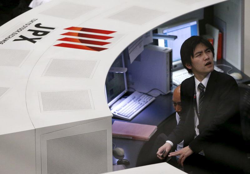 Employees of the Tokyo Stock Exchange (TSE) work at the bourse in Tokyo,