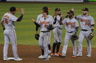 Baltimore Orioles players celebrate their win over the Miami Marlins, Tuesday, April 20, 2021, in Miami. (AP Photo/Marta Lavandier)
