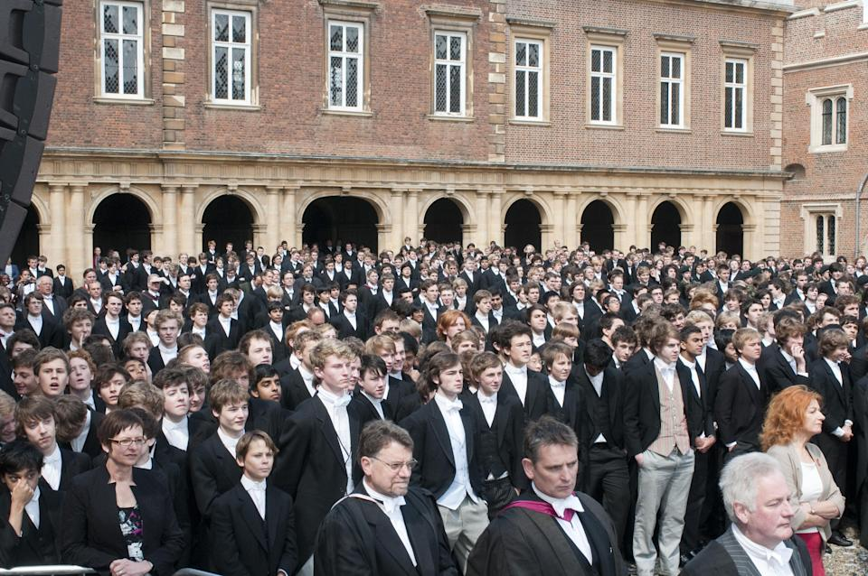 Pupils wait see Queen Elizabeth II as she visits Eton College in Berkshire to mark the 150th anniversary of the school.