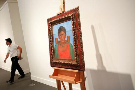 Artis Frida Kahlo's painting 'Nina Con Collar' sits on an easel at Sotheby's auction house in New York U.S., November 14, 2016. REUTERS/Shannon Stapleton