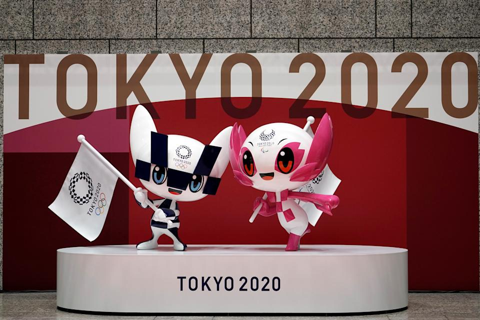 The statues of Miraitowa, left, and Someity, right, the official mascots for the Tokyo 2020 Olympics and Paralympics, are seen at an unveiling event marking 100 days before the start of the Olympic Games, at the Tokyo Metropolitan Government building, in Tokyo, Japan, April 14, 2021. Eugene Hoshiko/Pool via REUTERS - RC2FVM93Q294