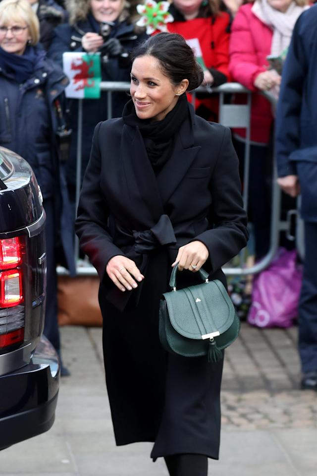 Meghan Markle with the bag during a walkabout at Cardiff Castle on January 18, 2018. [Photo: Getty]
