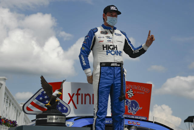 Chase Briscoe celebrates after winning a NASCAR Xfinity Series auto race at Pocono Raceway, Sunday, June 28, 2020, in Long Pond, Pa. (AP Photo/Matt Slocum)