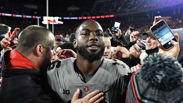 J.T. Barrett's heroics put Ohio State in the Big Ten East driver's seat, and the fifth-year senior at the front of the Heisman Trophy conversation. (AP)