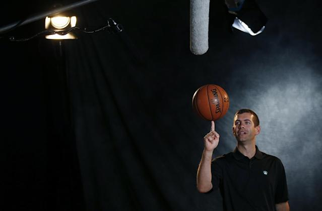 Boston Celtics basketball head coach Brad Stevens poses for a camera during team media day in Waltham, Mass., Monday, Sept. 30, 2013. (AP Photo/Elise Amendola)